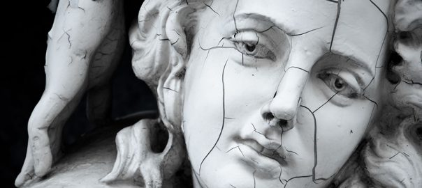 11479263 - cracked face of female greek sculpture